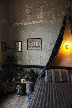 I would lighten it up a bit with some white bedding but I love the walls, floors and old school fans