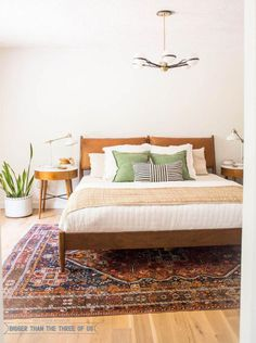 Mid Century Modern Bedroom featuring plants, white walls, boho textures and more. #midcenturymodern #midcenturybedroom #bohobedroom