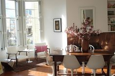 eclectic medium tone wood floor dining room with white walls wooden dining table and white chairs wooden vase brown rug of Reaching the Perfect Mid Century Modern Look in Your Dining Room