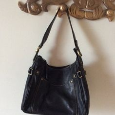 East 5th leather bag Black leather shoulder bag.  In very nice condition.   Zipper closure, pocket on front of bag and inside pockets. East 5th Bags Shoulder Bags