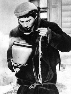 A young man in the Warsaw ghetto eats some food. Ration cards allowed ghetto residents only 300 calories of food daily, a small fraction needed for sustaining health. Photo credit: Meczenstwo Walka, Zaglada Zydów Polsce 1939-1945. Poland.