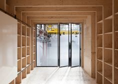 Stereo Architektur builds wooden installation in Basel factory