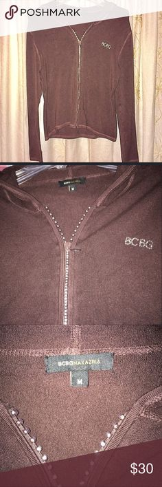 Chocolate Brown BCBG Zip Up Hooded Sweater Such a beautiful rich shade of chocolate brown! Super soft and stretchy sweater material accented with rhinestone zipper. Super cute and unique! Excellent condition. Looks adorable with tall boots. Check out my other listings to bundle and save 25% 😎! BCBG Sweaters Cardigans