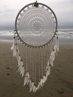 All white crochet dream catcher with white feathers handmade in Bali, Indonesia. Measures in diameter. Big Dream Catchers, Doily Dream Catchers, Dream Catcher White, Large Dream Catcher, Dream Catcher Boho, Crochet Feather, Crochet Dreamcatcher, Diy Dream Catcher Tutorial, Macrame Wall Hanging Diy