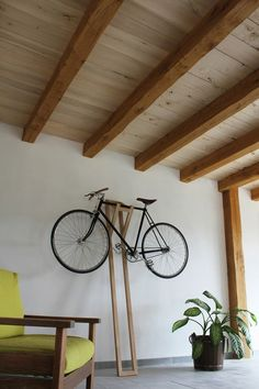 bike hanger - and this one wouldn't require anchoring in the walls.