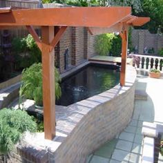 Build this simple above ground pond ideas in a weekend. It features a fountain and a trellis. Backyard Water Feature, Ponds Backyard, Garden Ponds, Garden Planters, Koi Fish Pond, Fish Ponds, Water Pond, Water Garden, Aquariums