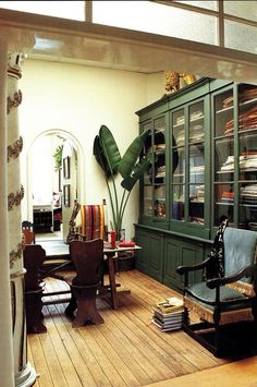 Green cabinets in a working library