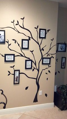Family tree wall done by my sisters. Tree stickers from Pier One. Frames we got in a garage sale but originally from Kohl's. Going to put black and white family photos in.
