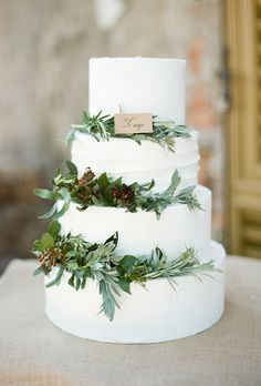 Brides: Four-Tiered Wedding Cake Decorated with Greenery. A traditional wedding cake goes country-chic with rustic greenery.