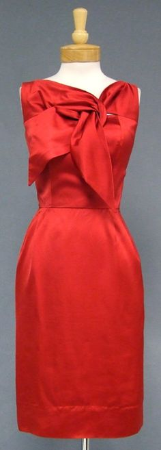 ~Cherry Red Satin Don Loper 1950's Cocktail Dress~  A wonderful bombshell cocktail dress from Don Loper. Thick cherry red sain. Sleeveless bodice with wonderfully styled ties. Fitted skirt with rear center seam vent. Rear metal zipper.~