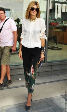 Sarah Rutson in structured white shirt, statement pants and pearl with spikes necklace