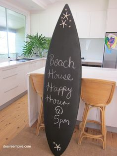 super simple diy - chalkboard paint on one of your old boards // via Desire Empire - Great idea for some of CABBI's beach B!