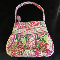 💐OFFER ME 👜Vera Bradley Pinwheel pink green bag Pre loved great condition. Posted on ♏️ercari and local sites. Authentic. Matching items available.  🌟ALL MY PRICES ARE NEGOTIABLE ❤️ POSTED ON OTHER SITES🌟 NO TRADES 🌺 MAKE AN OFFER 🎉 BUNDLE AND SAVE MORE 🌟 Vera Bradley Accessories Bags