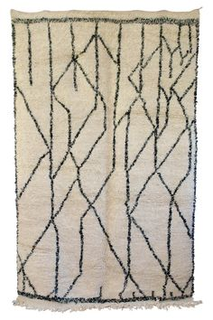 This vintage Moroccan Boujad carpet is like a modern work of art.  All hand knotted. All wool. Beige with soft black patterning.  All wool. Whenever I get these carpets they sell out very quickly and so grab yours. Available at Maryam Montague's online Souk!