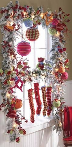 colorful christmas window decoration -- I love the skinny stockings! Noel Christmas, Winter Christmas, All Things Christmas, Christmas Wreaths, Christmas Crafts, Christmas Ornaments, Whimsical Christmas, Christmas Windows, Christmas Kitchen