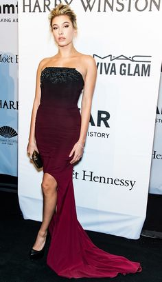 Hailey Baldwin in a deep burgundy gown and Harry Winston jewels