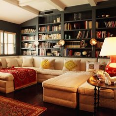 I love the huge couch and the wall of books. Perfection.