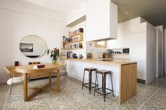 Located in Barcelona, Spain, this cozy apartment was designed by Nook Architects.