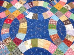 Quilting on a Double Wedding Ring quilt - from Jo's Country Junction I love the motif in the middle!