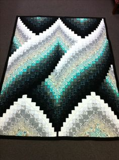 This is my fourth graduation quilt for my oldest nephew, a Texan whose favorite colors are black and white and turquoise. I picked this twisted Bargello pattern for him because he is a non-traditional, non-conformist. Black And White Quilts, Black Quilt, Black White, Turquoise Quilt, Bargello Quilts, Bargello Quilt Patterns, Barn Quilts, Quilting Designs, Quilt Design