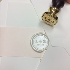 Custom wax seal die and the resulting seal in pearl white wax.