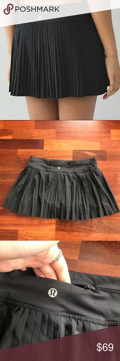 Lululemon Pleat to Street Black Tennis Skirt II Rare Lululemon Athletica Pleat to Street skirt. Only worn once. Cute pleated exterior skirt with interior short. Includes a little back pocket great for storing your key or credit card. This skirt is a great choice for going for a run, dancing, or just grabbing a latte. lululemon athletica Skirts Mini