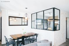 Z L Construction (Singapore) \\ Dining area with lattice windows and Craftstone walls