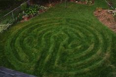 """A little more labor-intensive is the mounded grass labyrinth–creators Stephen Endres and Greg Luzt say it takes their client about an hour of string-trimming a week!"""