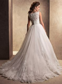 Willow - A modern vision for a classic style, this tulle with corded lace ball gown features an illusion lace bodice with bateau neckline and full skirt, magnificently detailed with lace scallops and delicately beaded trim at the waist. Finished with zipper and covered button over inner corset closure. $1398.00