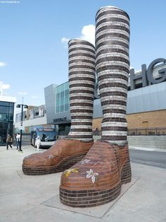 These 20 foot tall legs greet commuters and visitors by bus, train and car. They pay homage to the commuter and shoppers to Southgate Mall. The legs allow for a bit of imagination of a giant standing on the platform while also leading those in for a more intimate and tactile experience through the inlaid glass. Edmonton, AB