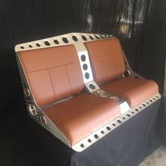 Bomber-style-bench-seat-with-console