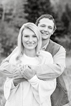 Fall Engagement Session - Black and White - Outdoor - Red Lodge - Montana - Engaged Couple - Fiancé - Man - Woman - Trees - Arms Around - Hugging - White Sweater - Denim Shirt - Carhartt Vest - Montana Wedding Photographer - Sara Nagel Photography Fall Engagement, Engagement Couple, Engagement Session, Engagement Photos, Red Lodge Montana, Carhartt Vest, Montana Wedding, How To Pose, Denim Shirt