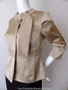 Fabrizio-Lenzi-Jacket-Size-42-AU-10-US-6-Ladies-Taupe-Evening-Made-In-Italy From the home of fashion comes this evening jacket from Fabrizio Lenzi. Made in Italy from 59% cotton and 41% viscose it will add a touch of elegance to any outfit. It has four hidden snap buttons and a round collar with an attached tie feature which can be left to hang loose or threaded through the collar loop.It has 3/4 length sleeves with splits which allows them to be turned back to form cuffs.