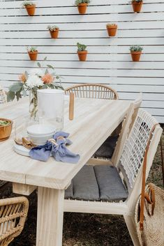 Backyard teak dining table and chairs, privacy fence with plants