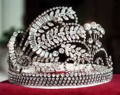 """Each year the Pasadena Tournament of Roses selects a girl from the greater Pasadena-area to be crowned Queen of the Tournament of Roses, or one of the members of her """"Royal Court"""". Each year over 1,000 girls between the ages  17 to 21 try out. Six princesses and one queen are chosen. This crown was worn by the 1968 Rose Queen, Linda Strother."""