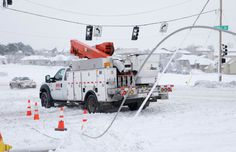 A local crew in Omaha, NE, clears a downed power line and protects people from crossing it. #altec #stormrecovery