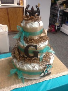 Diaper cake baby boy country rustic western, I LOVE the burlap! There will be lots of burlap im thinkin :)
