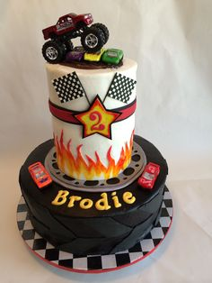 Monster Truck Cake - Monster Truck Cake. Crusting buttercream with fondant decorations and toy cars.