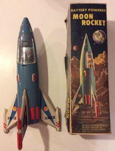 Rare 1956 Tin Moon Rocket XM-12 with Original Box by xRainbonesx on Etsy https://www.etsy.com/listing/224217339/rare-1956-tin-moon-rocket-xm-12-with