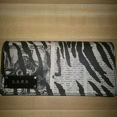 L.A.M.B. Animal Print Wallet Gently Used Newspaper/zebra print wallet features:  8 card slots 1 back pocket Zippered coin purse on inside 3 pockets for cash All the zippers work great. No tears/rips. I did notice that thread is pulling away a little bit by the snap. There is one little scratch on the inside of the wallet. I've only had it for 3 months. I bought it authentic off of Threadflip. It was gently used. I love this thing but I need a wallet with more card slots. L.A.M.B. Bags…