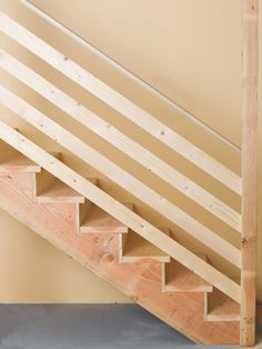 Interesting railing idea for basement stairs. Would look good being stained with the opposite wall being washed brick.