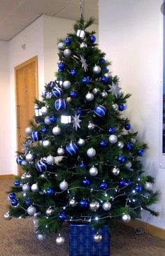 put a small blue and silver christmas tree in the boys room with white lights or if its a white tree maybe do blue lights