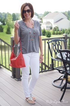 Simple Summer Chic: Grey Tee + White Jeans. The coral bag lends a fun contrast.