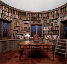 Library room in silo of bar home.