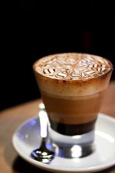Bicerin, a traditional drink native to Turin, Italy. It's made of espresso, chocolate syrup, and whole milk layered in a rounded glass.