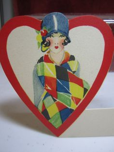 Gorgeous art deco 1920's-30's die cut  heart shaped place card pretty flapper girl in blue cloche with matching clothing colorful deco scarf. via Etsy.