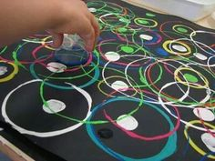Circle painting with cups and lids (my hubby would finally have to let me hang up one of my fav styles of artwork)