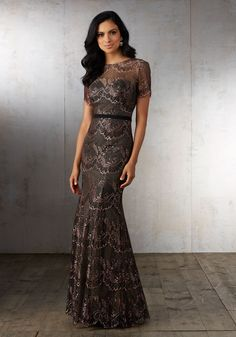 Evening Dresses and Mother of the Bride Dresses by Morilee by Madeline Gardner. Delicate Lace Social Occasion Gown with short Sleeves and Satin Waistband.