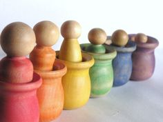 rainbow peekaboo family, painted with nontoxic water based wash, sealed with beeswax and olive oil