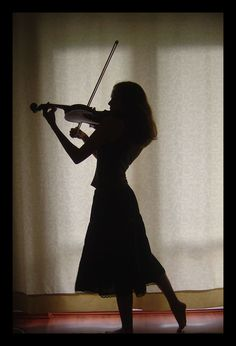 """She picked up my old violin and looked at it for a moment before putting it to her chin. She paused. Then she played the most gorgeous song I've ever heard. """"Where did you learn that?"""" I asked her. """"I, uh...I wrote it."""""""